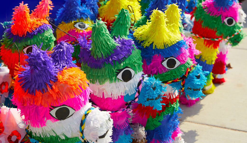 Chinese animal pinatas made of paper mache in a market.