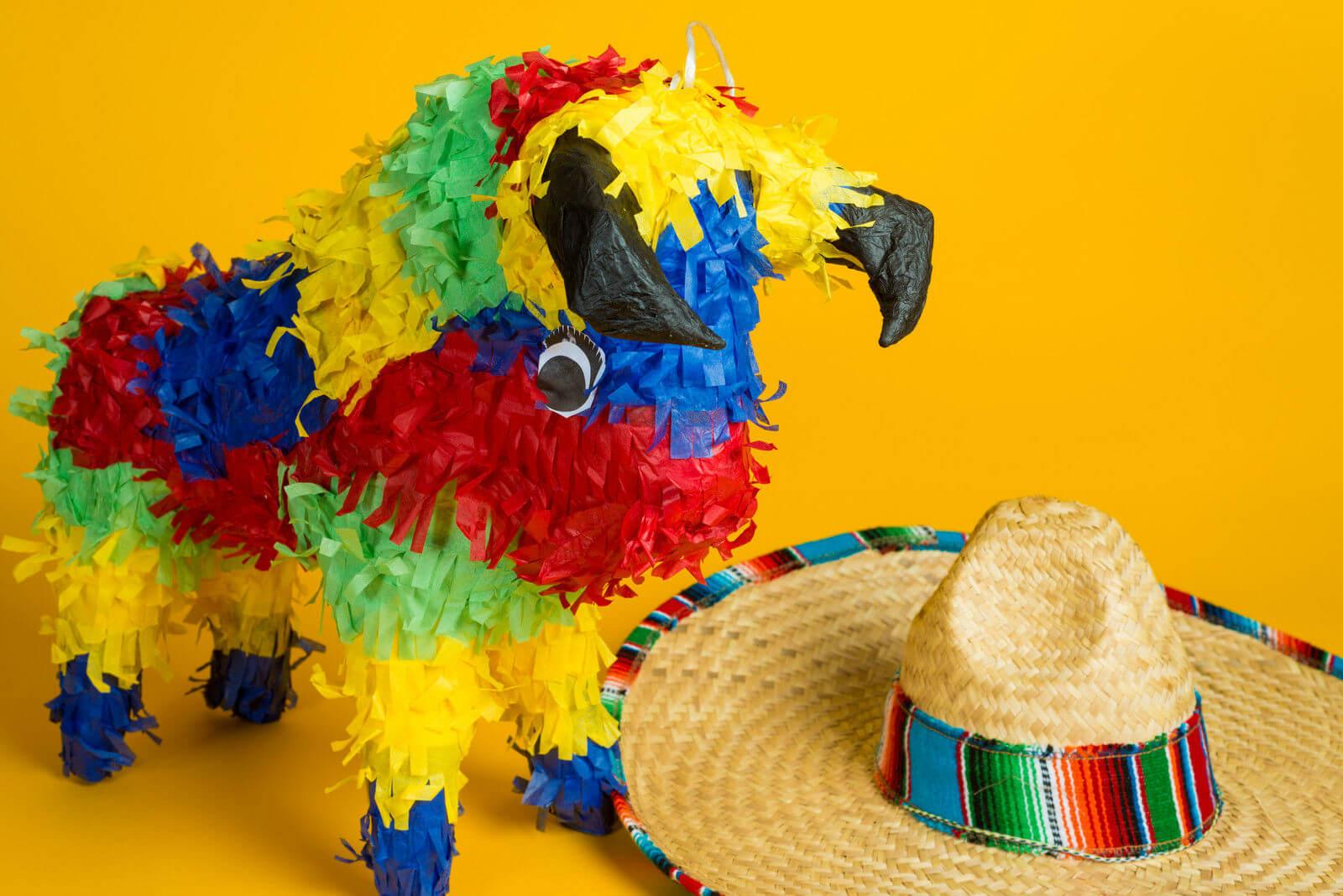 Paper-mache hand-made bull pinata and a mexican sombrero.