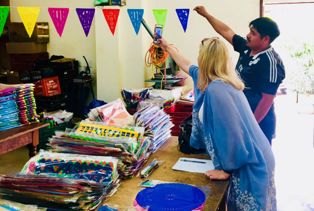 Allison Nevins shopping for the best papel picado in Mexico.
