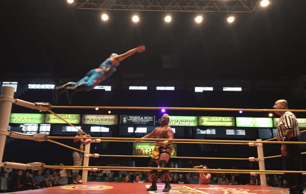 Luchador flying through the air in Guadalajara.