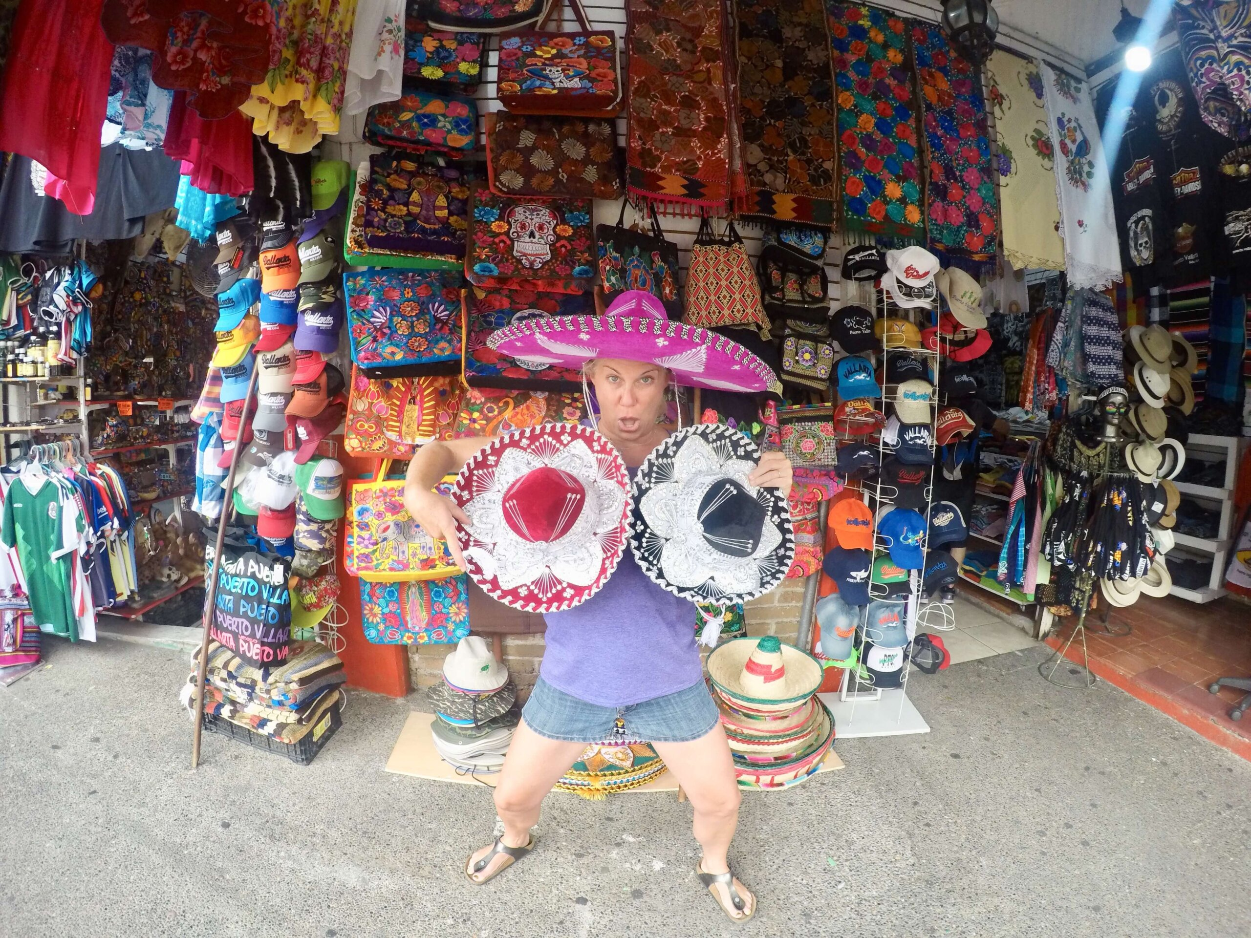Allison Nevins of TexMex Fun Stuff shopping for sombreros in the Mexican market in Puerto Vallarta.