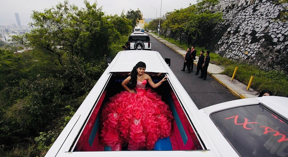 Quinceañera in her Limo going to church