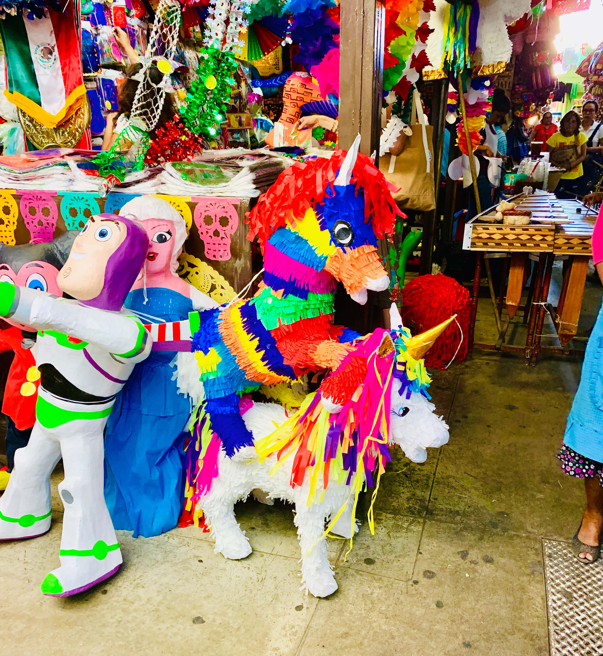 Mexican Mercado Piñatas that are unicorns.